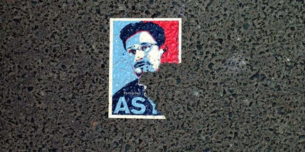 A sticker featuring fugitive US intelligence leaker Edward Snowden and partially reading