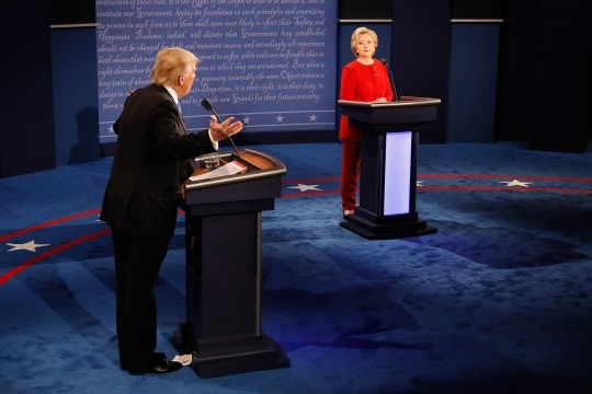 Republican presidential nominee Donald Trump gestures toward Democratic presidential nominee Hillary Clinton listens during the Presidential Debate at Hofstra University on September 26, 2016 in Hempstead, New York.