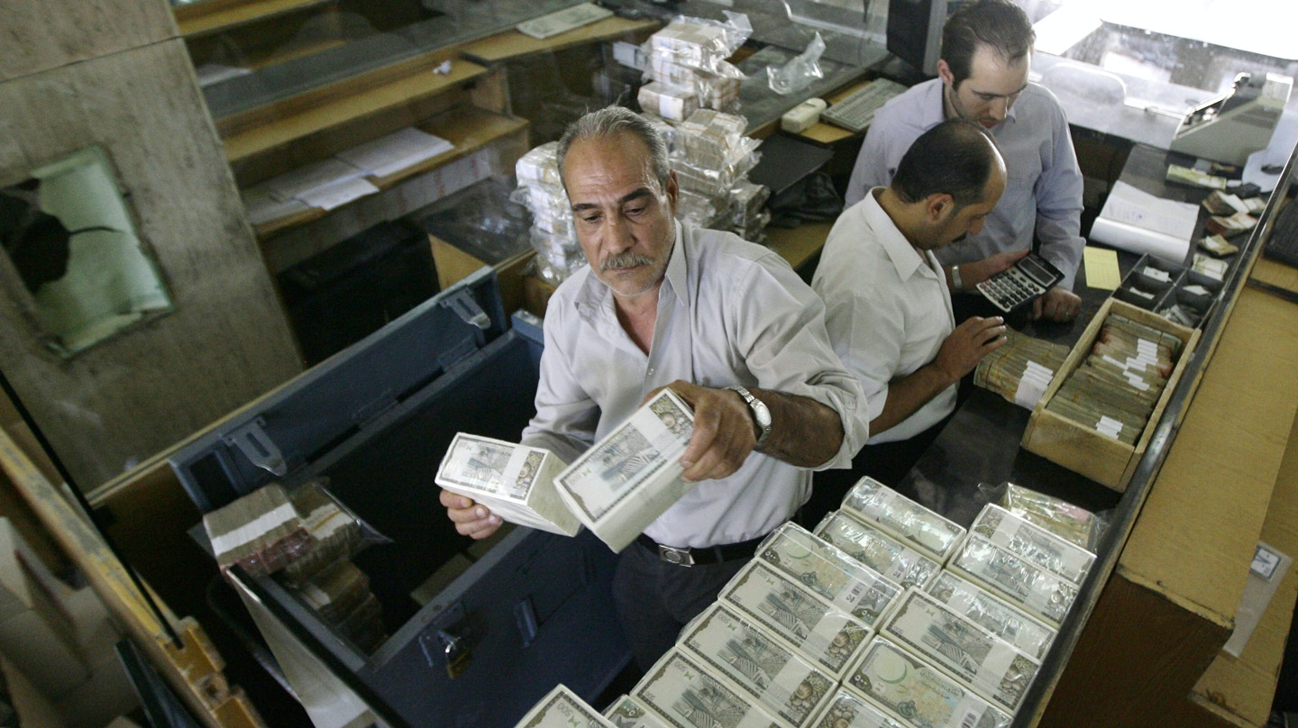 To Go With Afp Story By Sammy Ketza Banker Stacks Packed Syrian Lira Bills At The