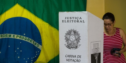 SAO BERNARDO DO CAMPO, BRAZIL - OCTOBER 26: A woman votes during the second round of elections on October 26, 2014 in Sao Bernardo do Campo, Brazil. Incumbent President Dilma Rousseff is competing against social democrat Aecio Neves for president. (Photo by Victor Moriyama/Getty Images)