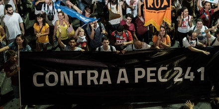 Opposers to President Michel Temer's economic recovery program, march against the constitutional amendment (PEC) 241, in Rio de Janeiro, Brazil, on October 17, 2016.Approved by Brazils lower house, the constitutional amendment limits budget increases to the rate of inflation for the next 20 years. Leftist lawmakers had fought against the spending cap, arguing that it would dramatically worsen conditions for ordinary Brazilians, especially the poor. / AFP / YASUYOSHI CHIBA (Photo credit should read YASUYOSHI CHIBA/AFP/Getty Images)