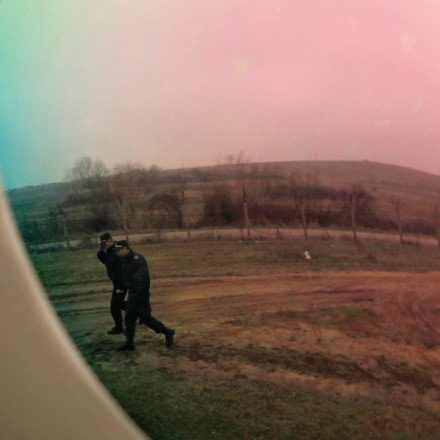 In the photo taken Thursday Jan. 20, 2011 Bulgarian border police are reflected in the lens of a thermal camera as they patrol the green-border near Kapitan Andreevo border crossing point between Bulgaria and Turkey, picture taken Thursday, Jan. 20, 2011. Both Bulgaria and Romania were hoping to join the passport-free Schengen zone, ahead of the next assessment meeting scheduled for Jan 28. 2011, but the process of the accession will likely be further delayed after Germany and France insisted the two countries demonstrate more progress against corruption and organized crime.(AP Photo / Valentina Petrova)