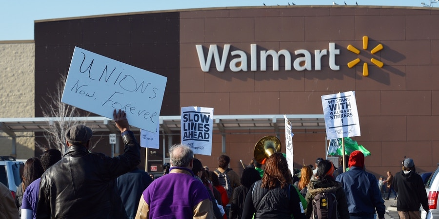 Groups supporting Walmart workers protest working conditions at the company in front of a Walmart Superstore on November 23, 2012 in Secaucus, New Jersey. Unhappy Walmart employees are protesting across the US, seeking to make their demands for better pay and benefits more visible to the Americans flocking to the Black Friday shopping frenzy.    AFP PHOTO/Stan HONDA        (Photo credit should read STAN HONDA/AFP/Getty Images)