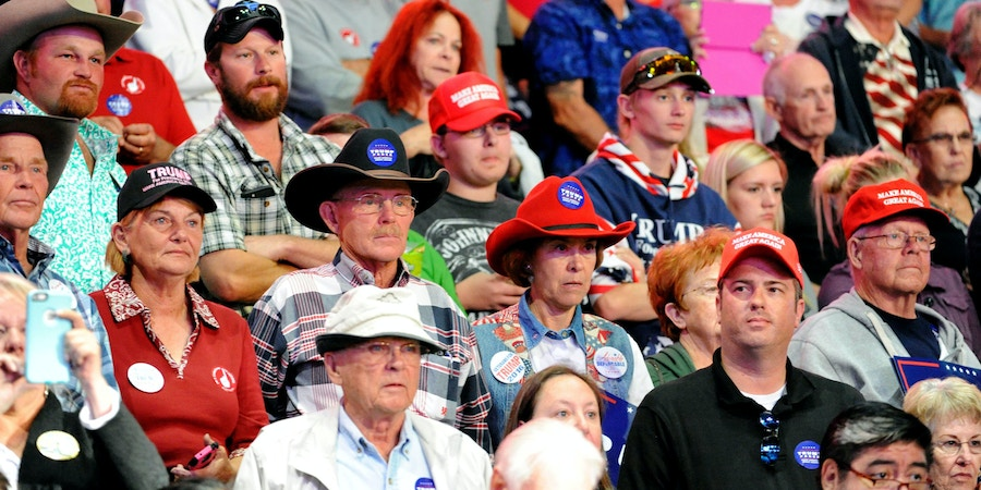 Supporters of Republican presidential nominee Donald Trump listen during his campaign stop at the Budweiser Events Center in Loveland, Colorado on October 3, 2016.  / AFP / Jason Connolly        (Photo credit should read JASON CONNOLLY/AFP/Getty Images)