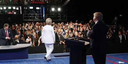 LAS VEGAS, NV - OCTOBER 19:  Democratic presidential nominee former Secretary of State Hillary Clinton walks off stage as Republican presidential nominee Donald Trump (R) looks on after the third U.S. presidential debate at the Thomas & Mack Center on October 19, 2016 in Las Vegas, Nevada. Tonight is the final debate ahead of Election Day on November 8.  (Photo by Joe Raedle/Getty Images)