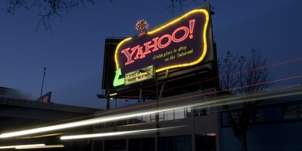 SAN FRANCISCO - FEBRUARY 1:  Cars drive down 6th Street past a Yahoo! billboard February 1, 2008 in San Francisco, California.  In an effort to compete with internet leader Google Inc., Microsoft Corp has made a $44.6 billion bid to buy Yahoo Inc..  (Photo by David Paul Morris/Getty Images)