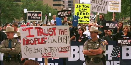 381733 11: Republican presidential candidate George W. Bush supporters face off outside the Texas Capitol November 11, 2000, in Austin, Texas. Bush, spending the weekend at his ranch, complained about the state of the presidential election being in