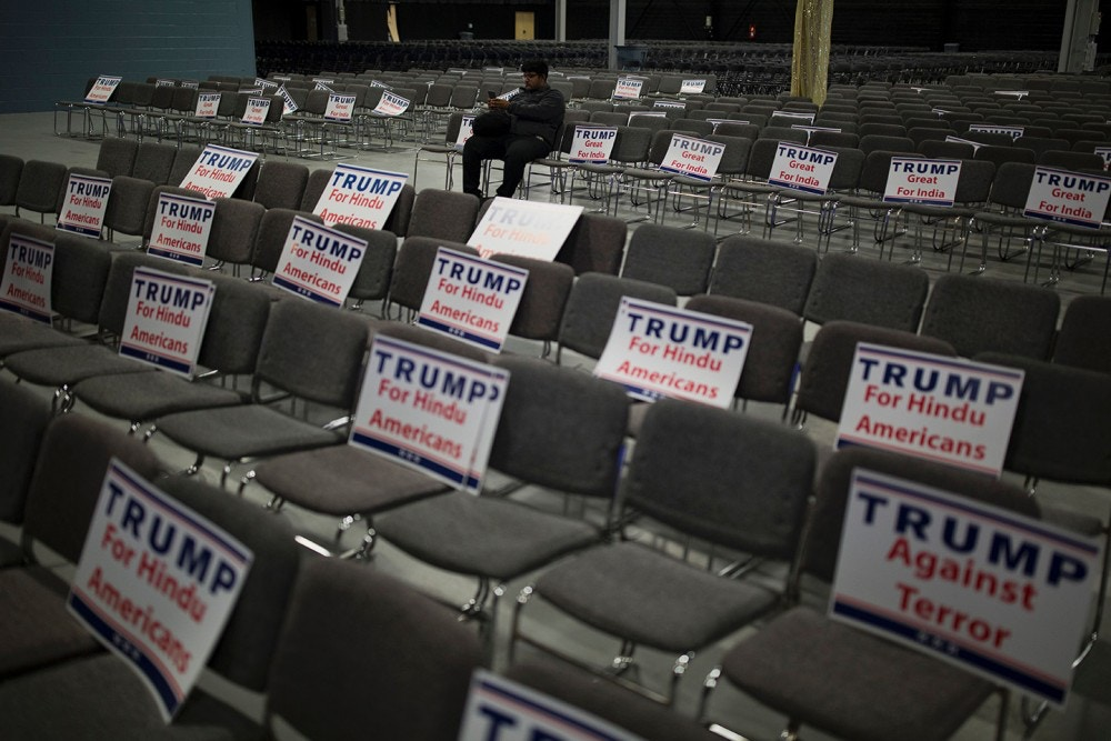 TOPSHOT - Signs expressing Hindu support for Republican presidential candidate Donald Trump are seen during a Hindu political organization's anti-terror fundraiser, October 15, 2016, in Edison, NJ. / AFP / DOMINICK REUTER        (Photo credit should read DOMINICK REUTER/AFP/Getty Images)