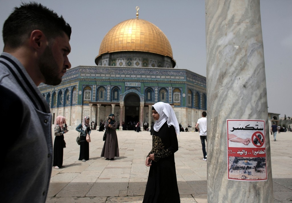 "A poster, calling for the destruction of CCTV cameras, is seen on a column at the Al-Aqsa Mosque compound in Jerusalem, in front of the Dome of the Rock on April 8, 2016.Jordan, who administrate the site, said it will set up security cameras around Jerusalem's flashpoint Al-Aqsa mosque compound in the coming days to monitor any Israeli ""violations."" / AFP / AHMAD GHARABLI (Photo credit should read AHMAD GHARABLI/AFP/Getty Images)"