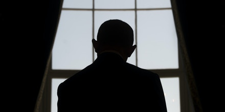 President Barack Obama looks out a window in the Blue Room at the White House in Washington, DC on April 13, 2016.
