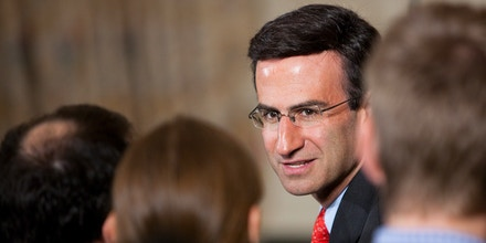 WASHINGTON - JULY 22:  Peter Orszag, director of the Office of Management and Budget, talks with guests before U.S. President Barack Obama signs the Improper Payments Elimination and Recovery Act at the White House on July 22, 2010 in Washington, D.C.  The signed bill will require federal agencies to put forth more funds towards audits to curb improper spending.  (Photo by Brendan Hoffman-Pool/Getty Images)