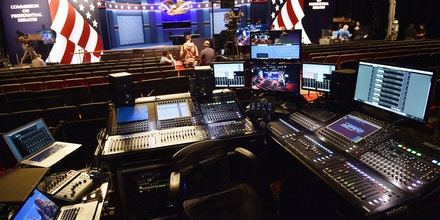 A control booth and the stage(rear) are seen as final preparations are checked on October 3, 2016 for the US vice-presidential debate with Republican candidate Mike Pence and Democratic candidate Tim Kaine at Longwood University, October 4, 2016, in Farmville, Virginia. After a dramatic week of beauty queens, sex tape allegations and tax leaks, the upcoming US vice presidential debate could feel like a throwback to simpler times.Featuring low-key career politicians, the match-up between Democrat Tim Kaine and Republican Mike Pence in Farmville, Virginia likely won't exude the reality show drama Americans have come to expect in the 2016 presidential election. / AFP / PAUL J. RICHARDS (Photo credit should read PAUL J. RICHARDS/AFP/Getty Images