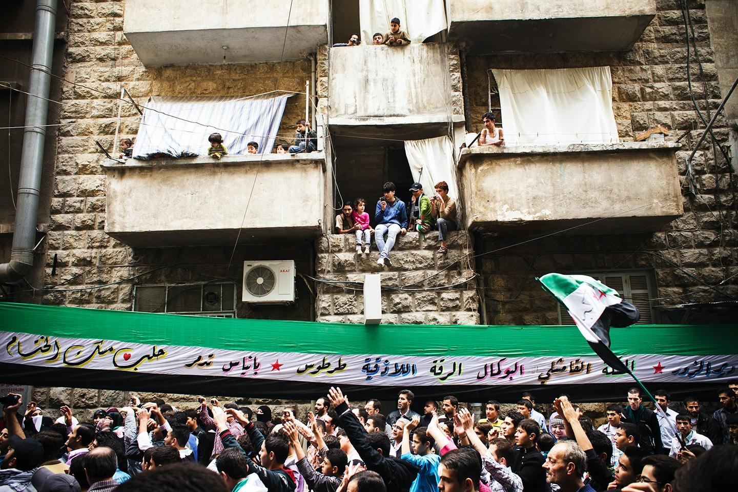 Syrian protesters gather in demonstration against the regime in the Bustan al-Qasr neighbourhood of the northern city of Aleppo on November 9, 2012. Syria President Bashar al-Assad said his future could only be decided at the ballot box and denied Syria was in a state of civil war, despite fresh attacks and heavy fighting near the Turkish border. AFP PHOTO/ACHILLEAS ZAVALLIS        (Photo credit should read ACHILLEAS ZAVALLIS/AFP/Getty Images)