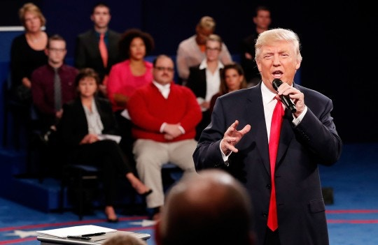 ST LOUIS, MO - OCTOBER 09:  Republican presidential nominee Donald Trump responds to a question during the town hall debate at Washington University on October 9, 2016 in St Louis, Missouri. This is the second of three presidential debates scheduled prior to the November 8th election.  (Photo by Rick Wilking-Pool/Getty Images)