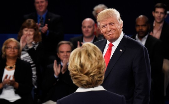ST LOUIS, MO - OCTOBER 09:  Republican presidential nominee Donald Trump looks at Democratic presidential nominee former Secretary of State Hillary Clinton during the town hall debate at Washington University on October 9, 2016 in St Louis, Missouri. This is the second of three presidential debates scheduled prior to the November 8th election.  (Photo by Saul Loeb-Pool/Getty Images)