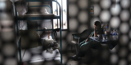 Immigrants sit in their housing cell in the women's wing of the detention facility for illegal immigrants on July 30, 2010 in Eloy, Arizona.