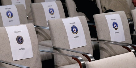 Chairs are labeled and reserved for represenatives from the various U.S. intelligence agencies before their chiefs, including Director of National Intelligence James Clapper, testify before the House Permanent Select Committee on Intelligence at the U.S. Capitol February 25, 2016 in Washington, DC.