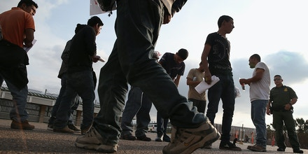 Undocumented immigrants await deportation by Border Patrol agents at the U.S.-Mexico border.