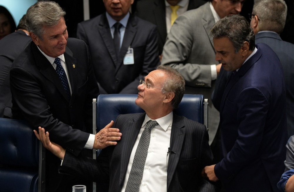 The president of the Brazilian Senate Renan Calheiros (C) speaks with Brazilian former President (1990-1992), Senator Fernando Collor de Mello (L), and opposition leader, Senator Aecio Neves (R), during a session to vote on Senator Delcidio do Amaral's cassation in Brasilia, on May 10, 2016.<br /><br /><br /><br /><br /><br /><br /><br /><br /> The interim speaker of Brazil's lower house of Congress Waldir Maranhao on Tuesday said he had reversed a decision to annul the impeachment of Brazilian President Dilma Rousseff after Calheiros on Monday had dismissed his annulment. / AFP / ANDRESSA ANHOLETE        (Photo credit should read ANDRESSA ANHOLETE/AFP/Getty Images)