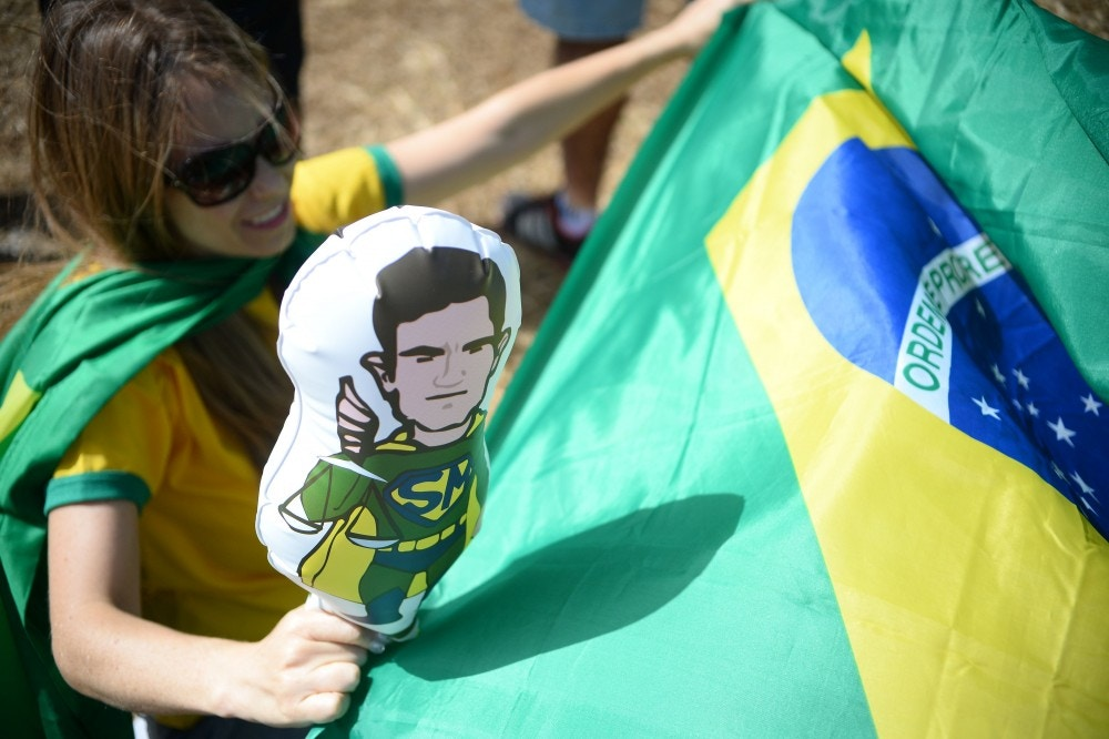 A woman holds an inflatable balloon depicting Brazilian judge Sergio Moro as a superhero, during a protest against suspended president Dilma Rousseff outside the National Congress in Brasilia, on July 31, 2016.Protesters took to the streets of Brazil on Sunday to demand the final leaving of suspended President Dilma Rousseff or to defend her continuance, just five days before the start of the Rio 2016 Olympic Games. / AFP / ANDRESSA ANHOLETE        (Photo credit should read ANDRESSA ANHOLETE/AFP/Getty Images)