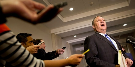 Reporters hold out recorders as House Benghazi Committee member Rep. Mike Pompeo, R-Kansas, speaks to the media on Capitol Hill in Washington, Friday, Oct. 16, 2015, during a break in testimony during a closed-door hearing of the House Benghazi Committee.