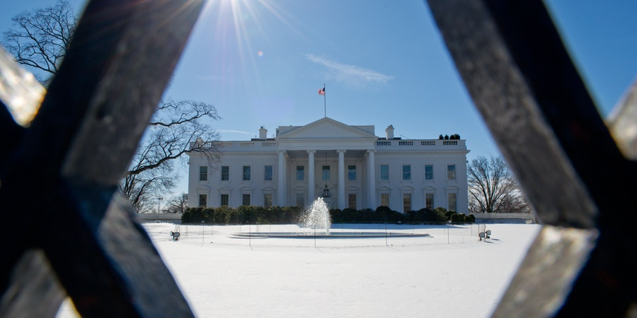 The White House is seen January 22, 2014 on a cold day in Washington, DC. Millions of Americans braved a miserable commute across the East coast Wednesday after a fierce storm dumped more than a foot of snow from the Mid-Atlantic to New England. The federal government stumbled back to work as bitter wind chills kept perishing temperatures 10 to 25 degrees below average with hundreds of flights canceled and roads still icy.   AFP PHOTO/Karen BLEIER        (Photo credit should read KAREN BLEIER/AFP/Getty Images)