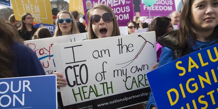 Supporters of women's health rally outside the Supreme Court in Washington, DC, March 23, 2016, as the Court hears oral arguments in 7 cases dealing with religious organizations that want to ban contraceptives from their health insurance policies on religious grounds. / AFP / SAUL LOEB        (Photo credit should read SAUL LOEB/AFP/Getty Images)