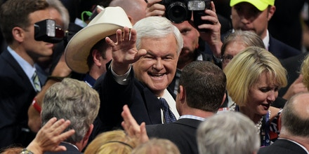 CLEVELAND, OH - JULY 18: Former Speaker of the House Newt Gingrich (L) waves to delegates on the floor prior to the start of the evening session on the first day of the Republican National Convention on July 18, 2016 at the Quicken Loans Arena in Cleveland, Ohio. An estimated 50,000 people are expected in Cleveland, including hundreds of protesters and members of the media. The four-day Republican National Convention kicks off on July 18. (Photo by Jeff Swensen/Getty Images)