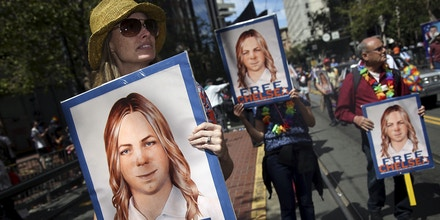 People hold signs calling for the release of imprisoned wikileaks whistleblower Chelsea Manning while marching in a gay pride parade in San Francisco, California June 28, 2015. Manning has appealed to an Army court to overturn her court-martial conviction, a court filing released on Thursday said.  REUTERS/Elijah Nouvelage/File Photo (Newscom TagID: rtrlseven871107.jpg) [Photo via Newscom]