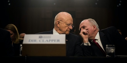 WASHINGTON, DC - FEBRUARY 9: Director of National Intelligence James Clapper speaks to CIA Director John Brennan before the start of the Senate (Select) Intelligence Committee hearing at the Hart Senate Building on February 9, 2016 in Washington, D.C. The committee met to hear testimony about worldwide threats to America and its allies.(Photo by Gabriella Demczuk/Getty Images)