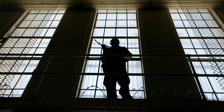 A guard stands watch over the east block of death row at San Quentin State Prison Tuesday, Aug. 16, 2016, in San Quentin, Calif. A pair of November ballot measures will decide the future of the death penalty in California. As of Aug. 1, 2016, there were 700 condemned inmates at the prison. (AP Photo/Eric Risberg)