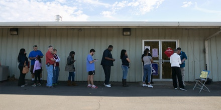 LAWRENCEVILLE, GA - NOVEMBER 08: Voters line up at the Gwinnett County Fairgrounds polling location on November 8, 2016 in Lawrenceville, Georgia. After a contentious campaign season, Americans go to the polls today to choose the next president of the United States. (Photo by Jessica McGowan/Getty Images)