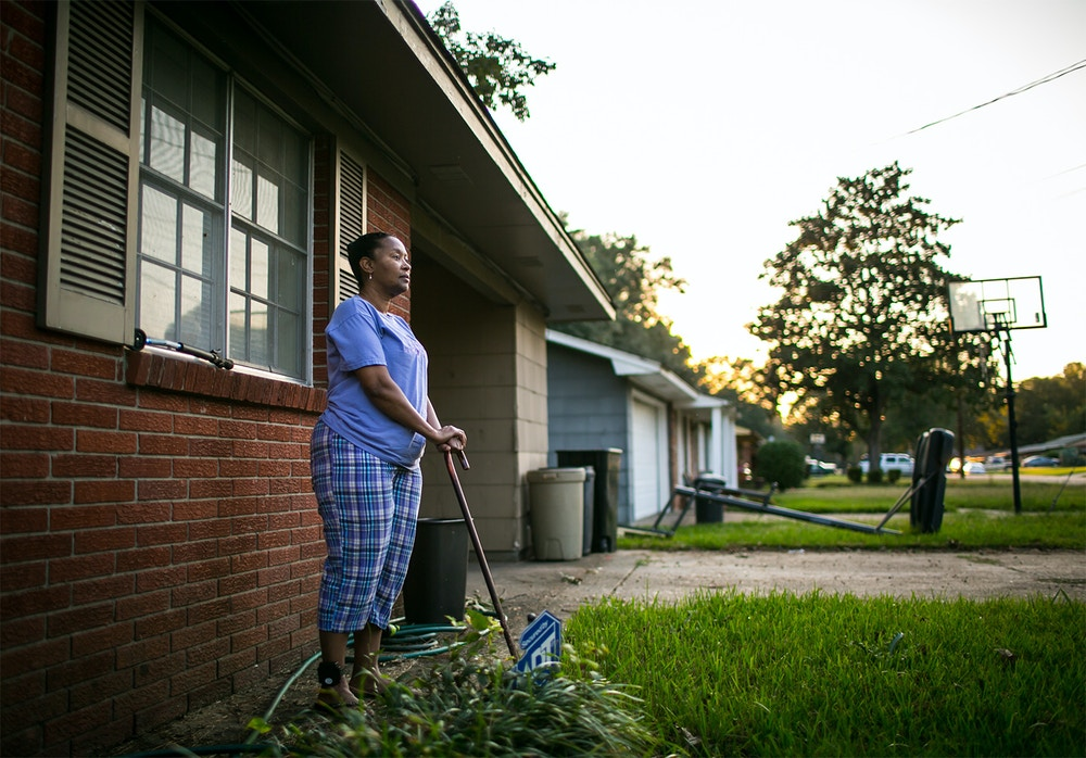 Tennie White outside of her home in Jackson, Mississippi. Currently on house arrest after 32 months in prison, Tennie cannot walk farther than her mailbox. Ms. White helped to uncover contaminated areas from the Kerr McGee site and was later charged with tampering with evidence during court trials against the company for environmental pollution. During her prison sentencing, the judge assured Tennie she would receive medical attention for her cataracts, for which she was already planning to undergo surgery. Being refused the appropriate medical care, she is now legally blind after being released to her home.