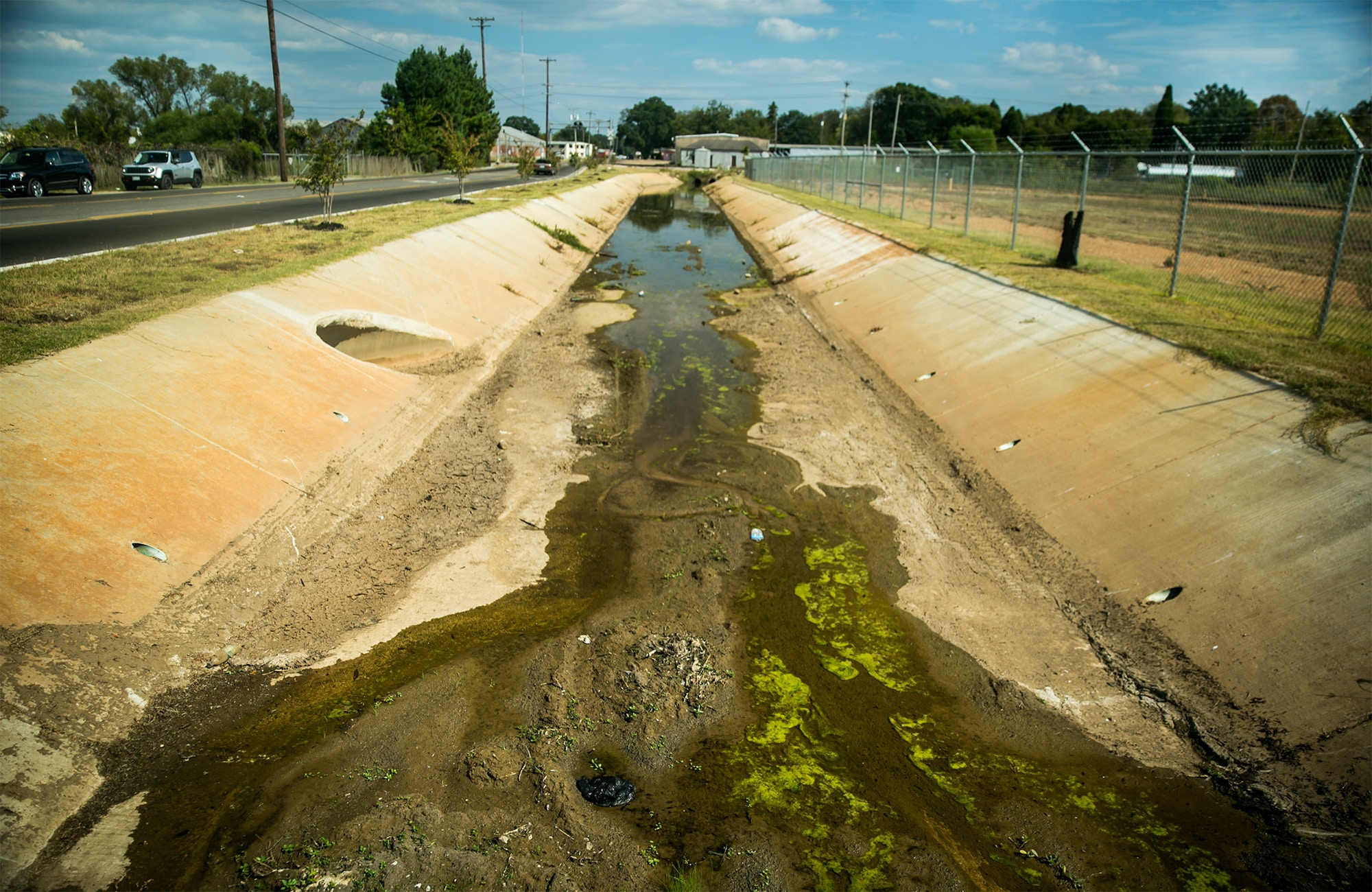 A polluted ditch containing creosote runs along the property of the old Kerr McGee site in Columbus, Mississippi.