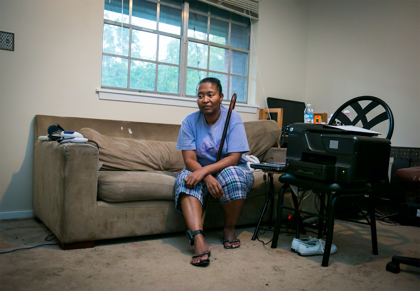 Tennie White at her home in Jackson, Mississippi. Currently on house arrest after 32 months in prison, Tennie cannot walk farther than her mailbox. Ms. White helped to uncover contaminated areas from the Kerr McGee site and was later charged with tampering with evidence during court trials against the company for environmental pollution. During her prison sentencing, the judge assured Tennie she would receive medical attention for her cataracts, for which she was already planning to undergo surgery. Being refused the appropriate medical care, she is now legally blind after being released to her home. Now, Tennie uses her living room as a home office to continue fighting against the company for health issues and contamination caused from creosote pollution in Columbus, Mississippi.