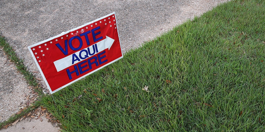 AUSTIN, TX - APRIL 28:  A bilingual sign stands outside a polling center at public library ahead of local elections on April 28, 2013 in Austin, Texas. Early voting was due to begin Monday ahead of May 11 statewide county elections.  The Democratic and Republican parties are vying for the Latino vote nationwide following President Obama's landslide victory among Hispanic voters in the 2012 election.  (Photo by John Moore/Getty Images)