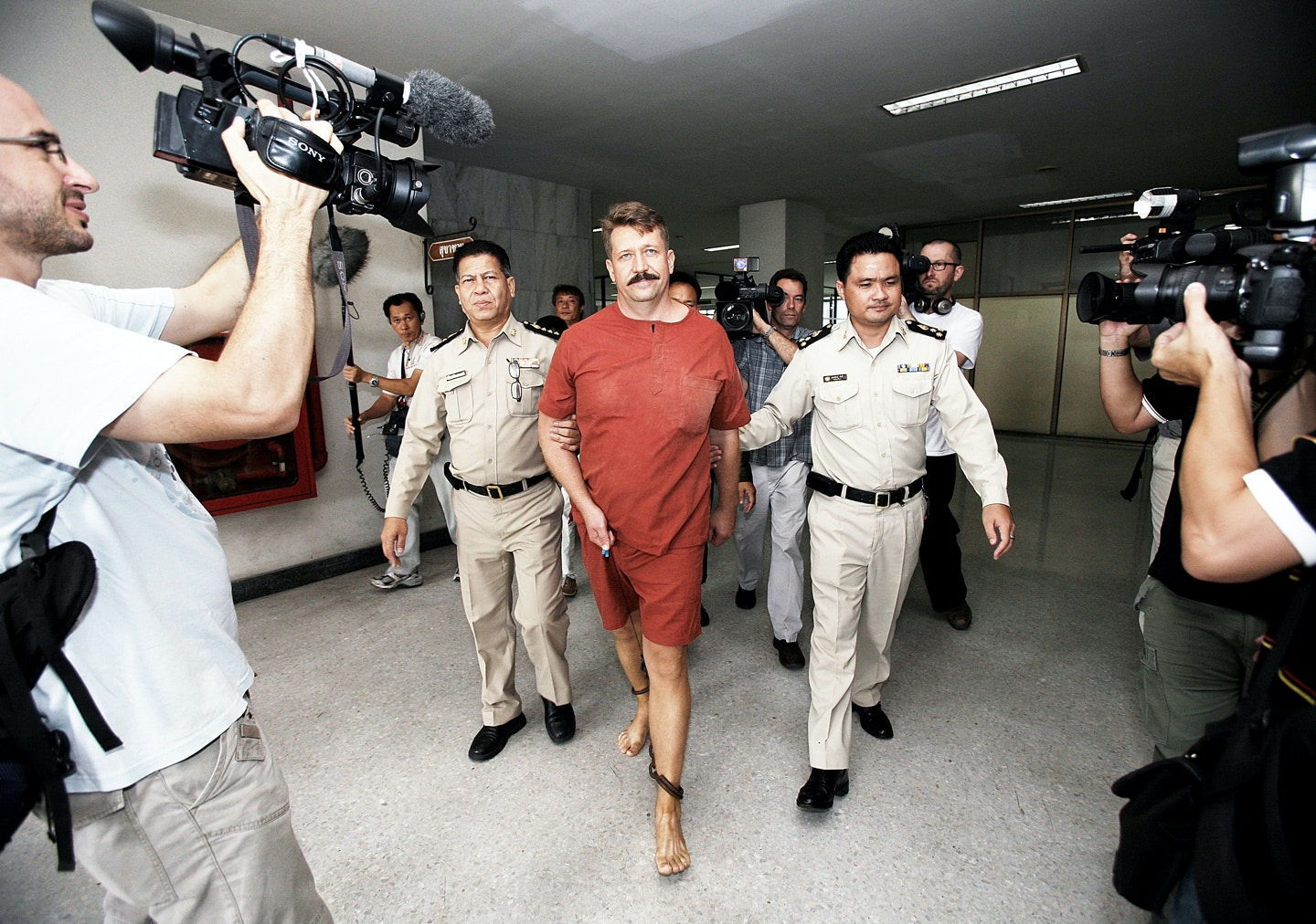 BANGKOK, THAILAND - JULY 28: Arms Dealer Viktor Bout arrive at Bangkok Supreme Court on July 28, 2008, in Bangkok, Thailand. A Thai court delayed reputed Russian arms smuggler Viktor Bout's extradition hearing to the U.S. for a second time after his new defense attorney failed to show up for the high-profile case Monday.  (Photo by Chumsak Kanoknan/ Getty Images)