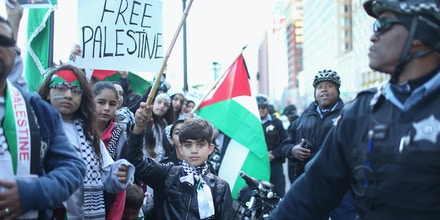 Demonstrators march in the Loop protesting recent deadly confrontations in Israel on October 18, 2015 in Chicago, Illinois. Hundreds of activists participated in the march calling for an end to what they perceive as Israeli aggression in the occupied West Bank and Gaza region.