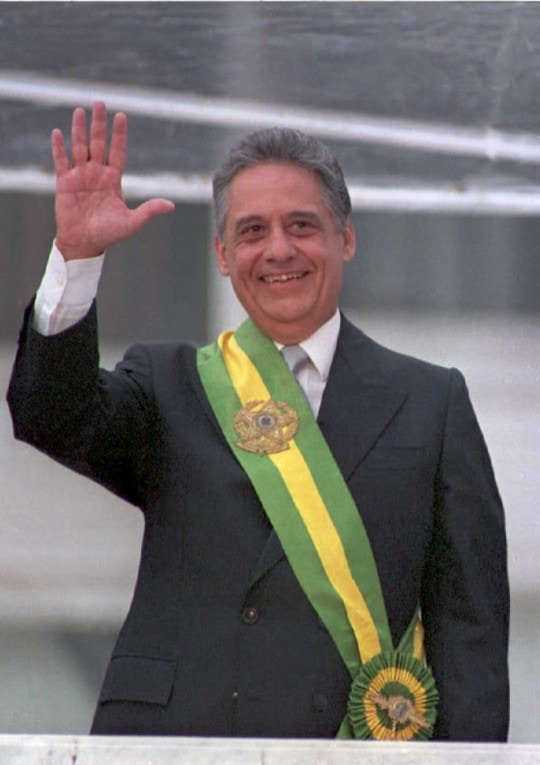 JANUARY 1:  Brazilian President Fernando Henrique Cardoso waves from the Planalto Palace in Brasilia after receiving the presidential sash from his predecessor Itamar Franco 01 January. Cardoso was elected 03 October with 54 million votes. (COLOR KEY: Green and yellow sash).  (Photo credit should read ANTONIO SCORZA/AFP/Getty Images)