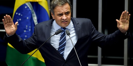 Brazilian senator Aecio Neves, from PSDB, delivers a speech during the debate in the Senate of a vote on suspending President Dilma Rousseff and launching an impeachment trial, in Brasilia on May 11, 2016. A simple majority in the 81-member Senate will trigger Rousseff's six-month suspension pending trial. A two-thirds majority would then be needed to remove her permanently. / AFP / EVARISTO SA (Photo credit should read EVARISTO SA/AFP/Getty Images)