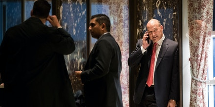 Gary Cohn, president and chief operating officer at Goldman Sachs, talks on his phone as he arrives at Trump Tower, November 29, 2016 in New York City.