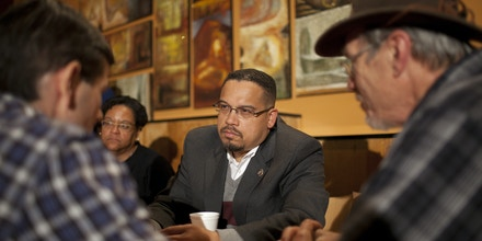 Rep. Keith Ellison listenes to Dr. Dave Dvorak, left, during his