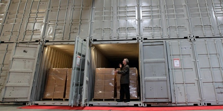 In this July 21, 2011 photo, Brewster Kahle, digital librarian for the Internet Archive, discusses how books are stored in converted shipping containers while being interviewed at the Internet Archive's Physical Archive warehouse in Richmond, Calif.