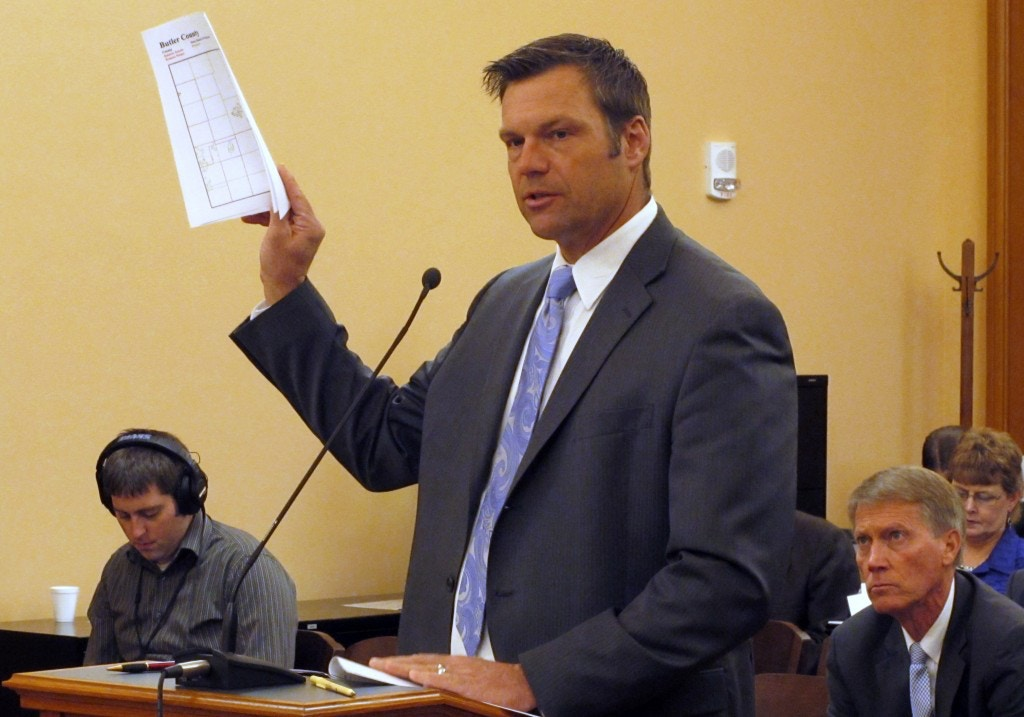 Kansas Secretary of State Kris Kobach testifies during a meeting of a legislative study committee on election issues, Friday, Nov. 21, 2014, at the Statehouse in Topeka, Kan. Kobach says he'll revive a proposal to allow his office to prosecute election fraud cases. (AP Photo/John Hanna)