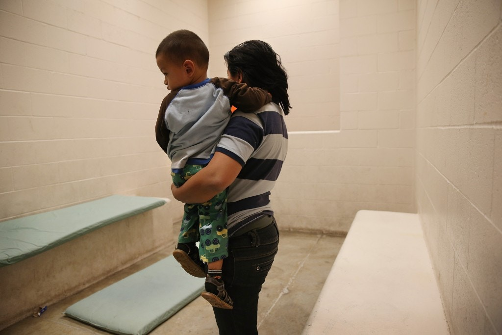 MCALLEN, TX - APRIL 11:  A Honduran mother holds her toddler son at the U.S. Border Patrol detainee processing center on April 11, 2013 in McAllen, Texas. They had been caught by the Border Patrol while crossing illegally from Mexico into Texas. According to the Border Patrol, undocumented immigrant crossings have increased more than 50 percent in Texas' Rio Grande Valley sector in the last year. With more apprehensions, they have struggled to deal with overcrowding while undocumented immigrants are processed for deportation. (Photo by John Moore/Getty Images)