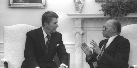 WASHINGTON, DC: (FILE PHOTO) US President Ronald Reagan (L) and Israeli Prime Minister Menahem Begin meet in the White House September 9, 1981 in Washington, DC. Reagan, the nation's longest living president, battled Alzheimer's disease for the past decade and passed away age 93, June 5, 2004 at his home in Bel Air, California. (Photo by Ya'akov Saar/GPO via Getty Images)