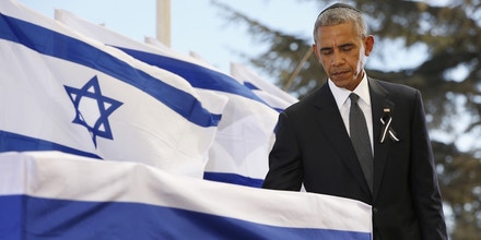 JERUSALEM, ISRAEL - SEPTEMBER 30:   U.S President Barack Obama touches the coffin of Shimon Peres after delivering his eulogy during the funeral at Mount Herzl Cemetery on September 30, 2016 in Jerusalem, Israel. World leaders and dignitaries from 70 countries attended tthe state funeral of Israel's ninth president, Shimon Peres, in Jerusalem on Friday, after thousands of Israelis paid their last respects to the elder statesman who died on Wednesday. (Photo by Abir Sultan- Pool/Getty Images)