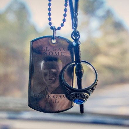 Catlin Carithers id tag hangs in his brother's car