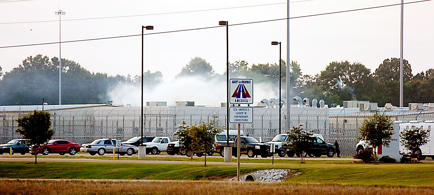 "Smoke rises above the Adams County Correctional Center in Natchez, Miss., Sunday, May 20, 2012, during an inmate disturbance at the prison. A guard at the southwest Mississippi prison died Sunday and several other employees were injured during what the facility's private operator is calling ""an inmate disturbance"" that continued into the evening.  (AP Photos/The Natchez Democrat, Lauren Wood)"