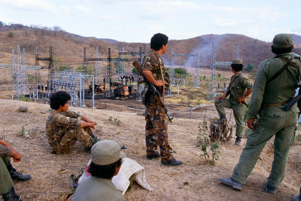 Sandinista soldiers guard an electrical substation in northern Nicaragua that has been attacked by guerrilla contras. Rising to power within the Nicaraguan government in the 1980s, the left-wing Sandinista National Liberation Front (FSLN) was opposed by contra military forces, who were covertly supported by the U.S. government during what was to become known as the Iran-Contra Affair. (Photo by © Shepard Sherbell/CORBIS SABA/Corbis via Getty Images)